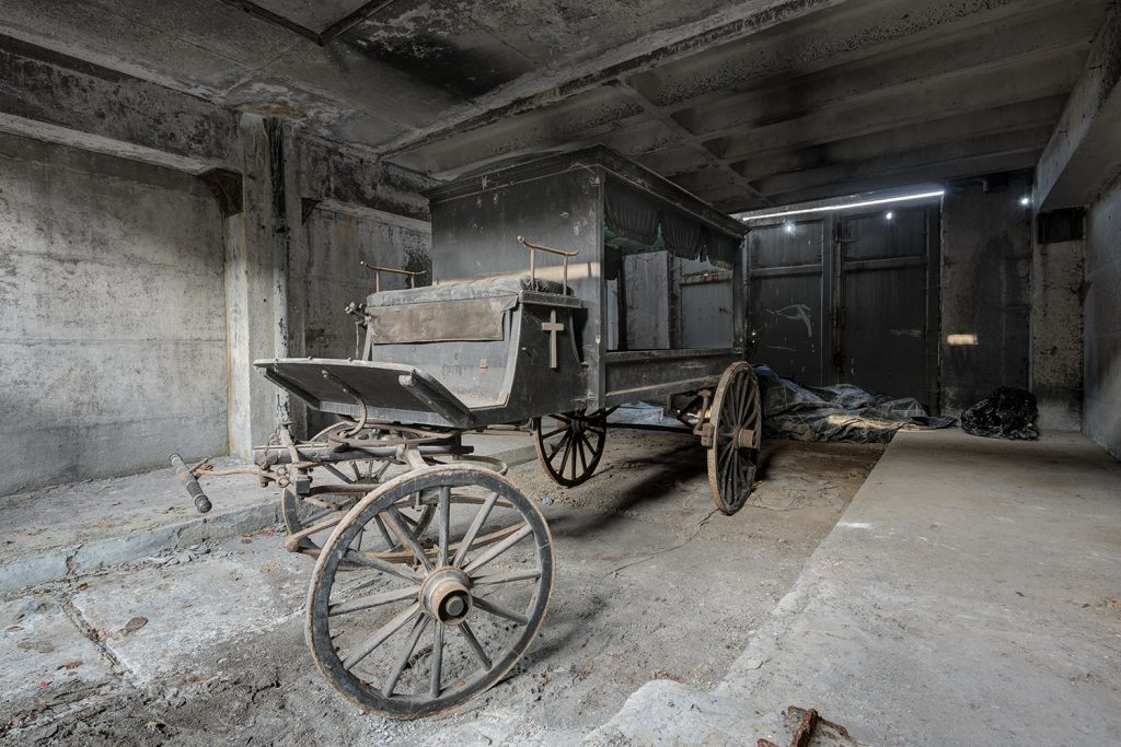 neglected and forgotten hearse in industry building